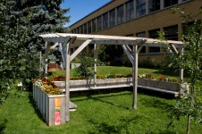 The outdoor classroom. The students decorated some of the slats.