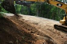 Building road runoff swales.